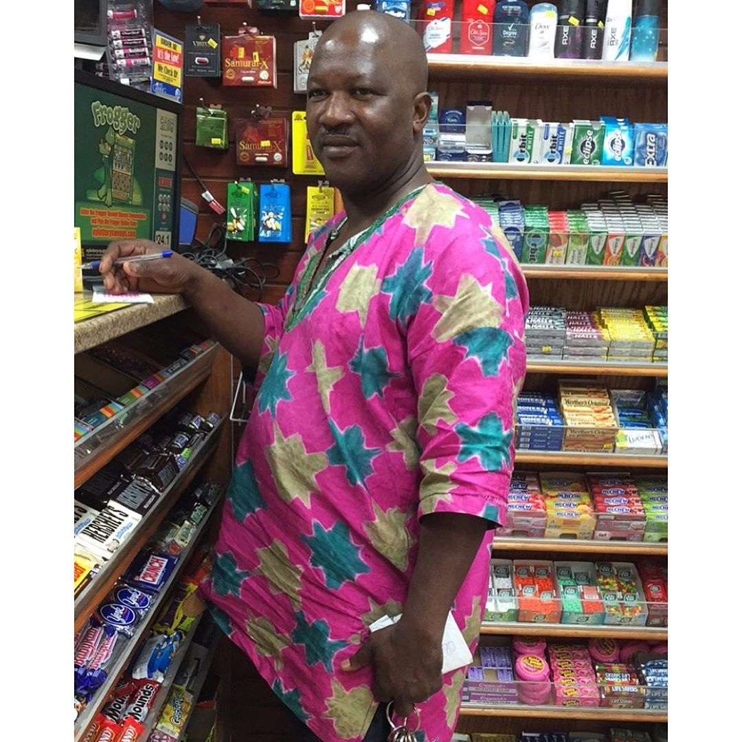 His shirt (from Nigeria) was the exact same colors of the lottery paper he was filling out.