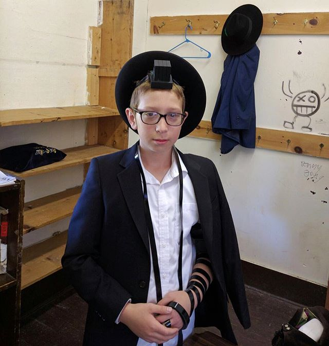 "Mazel Tov! My nephew Chaim Lemel started putting on tefillin!  A Jewish boy, upon reaching his 13th birthday, is regarded as a full fledged Jew. He then becomes a ""Bar Mitzvah,"" meaning that he is begins to keep and perform all the laws and customs of the Jewish people. One of them is is Tefillin.  It is customary to initiate the boy into the practice of donning the Tefillin 2-3 months before the actual date of his Bar Mitzvah. When purchasing a pair of Tefillin, care should be taken to buy it from a dependable store in order to be sure the Tefillin are hand-written by a duly qualified Scribe (sofer). Those not produced in conformity with the specified requirements of Tefillin, may not be used. Tefillin is donned Sunday through Friday only. Tefillin are worn during the morning prayers. However, if for some reason it was impossible to do so in the morning, Tefillin may still be put on later in the day, but not after sunset"