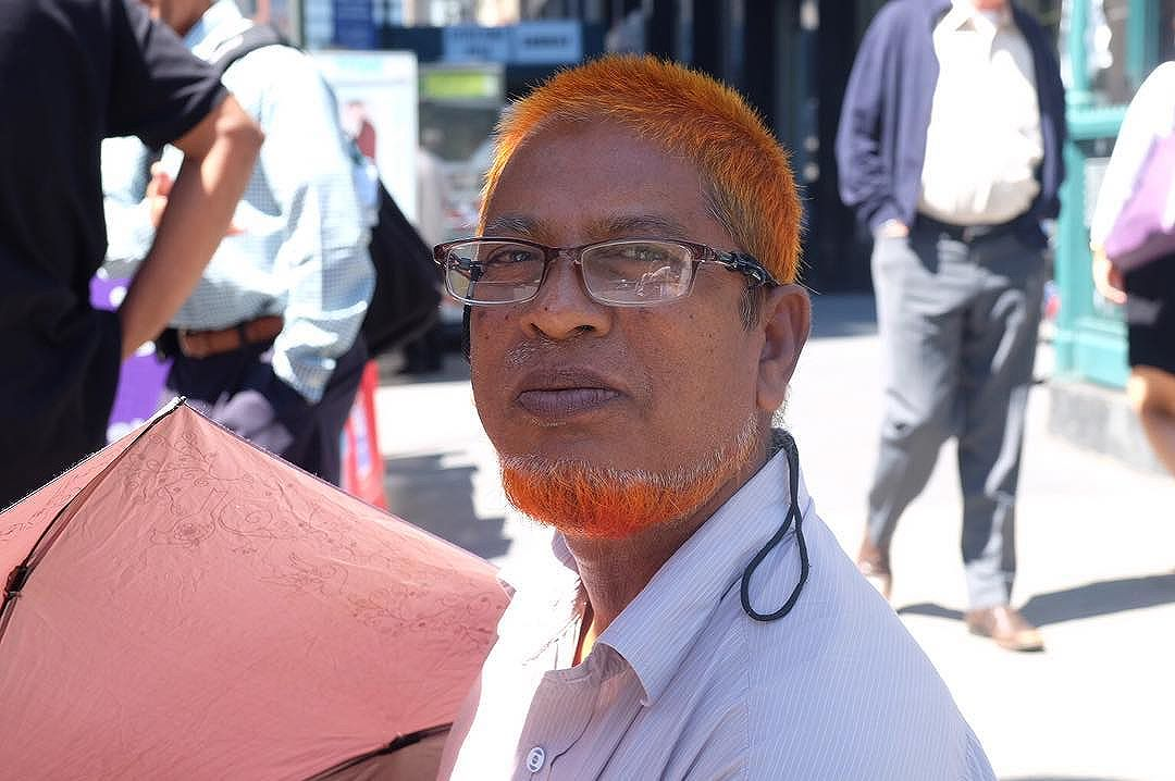 I've always wondered why men from certain places dye their beard/hair orange and this fella from Bangladesh told me it's a sign of doing well. I did some googling and they're not allowed to use dye that isn't henna) So very cool. He also said it makes people happy! I did read once that looking at orange is supposed to make you happy. Man, I'd be checking myself out all day! I'd be the happiest camper!