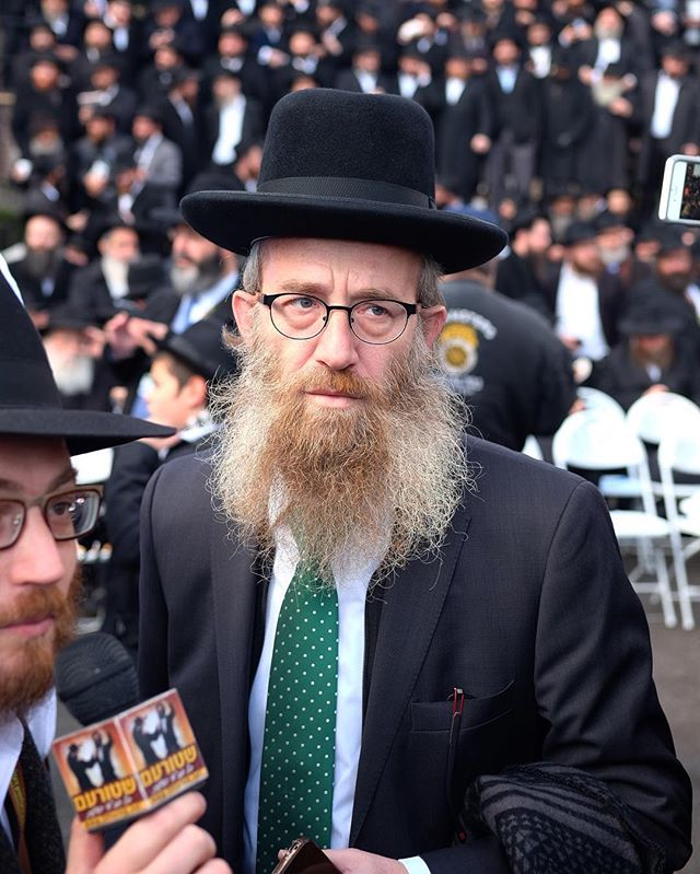 Chabad Chassidim typically wear a fedora so the few that don't really stand out. It's interesting when chassidim borrow from each other's style. I'm sure it's for a good reason. (Perhaps he grew up in a non-chabad family)
