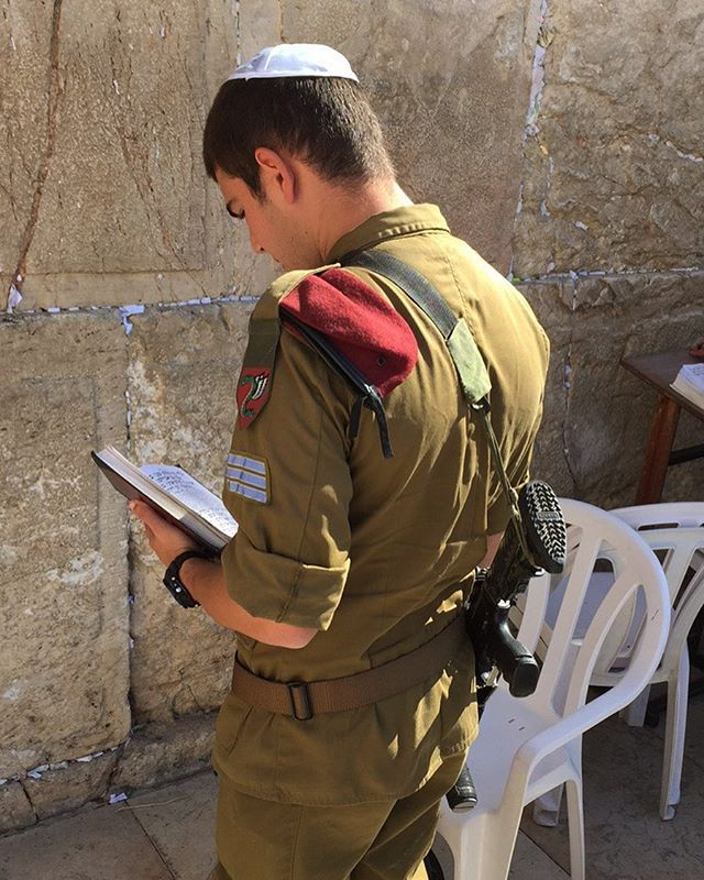 A soldier prays at the Western Wall