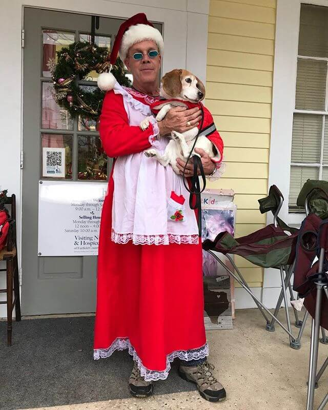 Dudes wife works at a thrift shop, the Mrs. Claus dress came in and he said he's wearing it to work. His boss dared him and so he did. He runs security for WWE.
