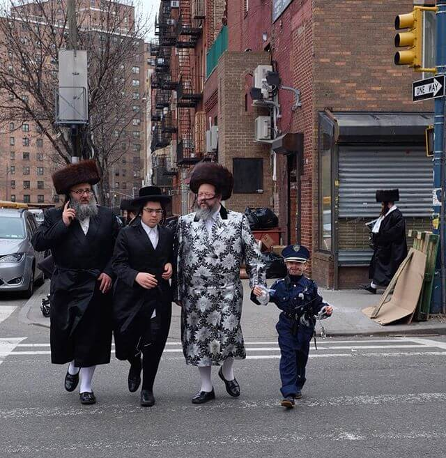 it's almost shabbos. For the holiday chassidic people wear their finest, similar to what they wear on shabbos. Imagine that, uniform...and to wear it wed night (jewish holidays start at night) Thursday and again Friday night into Saturday for the sabbath. (In some sects of chassidim, only children wear costumes for #Purim)