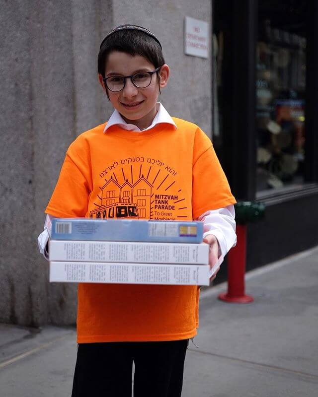 """I grew up going on just like this young yeshiva student. (Although we weren't as cool and didn't have t shirts to wear over our white shirts) Mitzvah Campaigns, or Mivtzo'im (Hebrew: מבצעים) refer to the various mitzvah campaigns launched by the Lubavitcher Rebbe, Rabbi Menachem Mendel Schneerson, for observance by all Jews. During the years 1967 to 1976, Rabbi Schneerson called all Jews to observe ten basic """"beginner's mitzvot""""— which, because of their centrality to the Torah's guide to life, are ideally suited for a first experience of the mitzvah connection. In the years that followed there were campaigns for additional mitzvot as well. Rabbi Schneerson urged all Jews to reach out to those less affiliated than themselves and encourage them to undertake specific practices of Judaism. This young boy is encouraging all Jews to use Shmurah Matza for the night of the Passover Seder."""