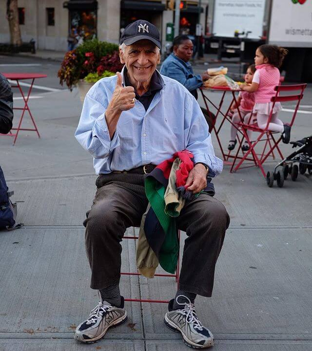 Popped collared polo under an oxford cloth button down (with some frumpiness but not shlumpy) tucked into striped trousers with walking sneakers. He said something about teaching (photography?) at NYU. Maybe someone can ID. @nyuniversity @nyuphotoj @tischphoto