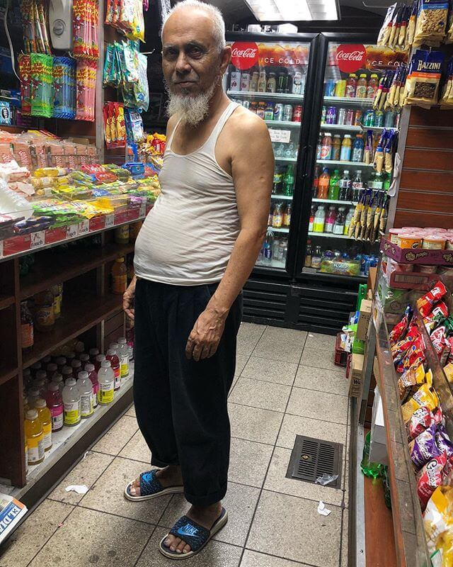 Pleated Underground. About two hours ago. A shopkeeper closes up for the night. In pleated chinos, a tank top and slides. This here fella cuffs his pants up NOT for style nor comfort I bet, but for his religion! I believe Muslim men are not supposed to cover their ankles but I'm not certain. I've heard/read a few different things on this. But I love that part of the muslim uniform.
